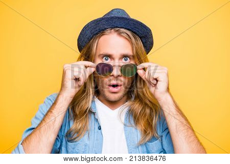 Really? Close Up Portrait Of Shocked Bearded Blond Attractive Guy Holding Glasses With Fingers, Amaz