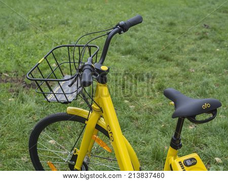 Yellow Bikecycle For Sharing Rental Unlock By Mobile App On Smarphone Ecological City Transport On G