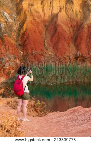 Girl Taking A Picture Of A Lake