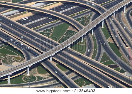 Traffic junction with cars from above. New traffic junction in Dubai. poster