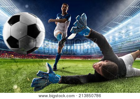 Goalkeeper kicks the ball in the stadium during a football game