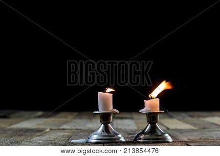 Blown Candles In Silver Candlesticks With Smoked Wick. Smoke From A Wick On A Black Background.