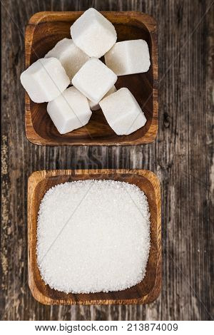Two Bowls Of Sugar  On A Wooden Background
