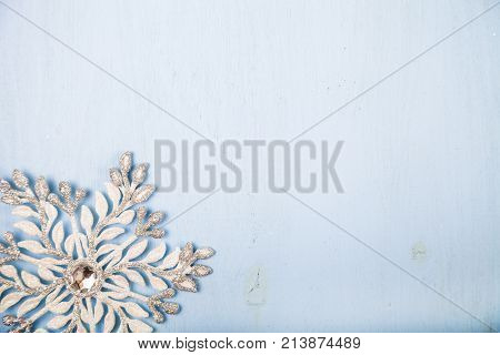 Silvery Snowflake On A  Wooden Background.