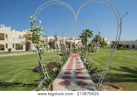 Formal landscaped gardens in grounds of a luxury tropical hotel resort with romantic valentine wedding pavilion pagoda