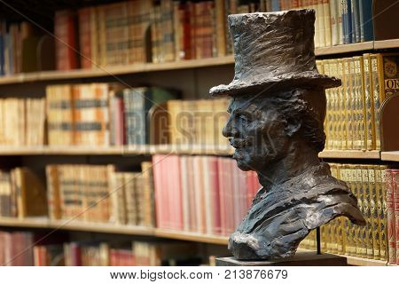 STOCKHOLM OCT 30 2017: Closeup of a statue of the author August Strindberg and books in a shelf in the city library in Stockholm called Stadsbiblioteket. October 30 2017 Stockholm Sweden.