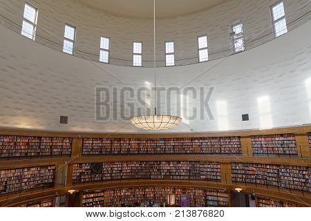 STOCKHOLM OCT 30 2017: Entrance of the city library in Stockholm called Stadsbiblioteket the beautiful central rotunda and lots of books. October 30 2017 Stockholm Sweden.