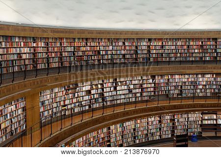 STOCKHOLM OCT 30 2017: Entrance of the city library in Stockholm called Stadsbiblioteket the beautiful central rotunda and lots of books in shelfs. October 30 2017 Stockholm Sweden.