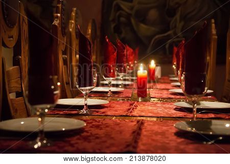 The restaurant has a rich wooden table claret tablecloths wooden expensive chairs candles on the table glasses.Cheap cafe. Dinner table. Empty restaurant.