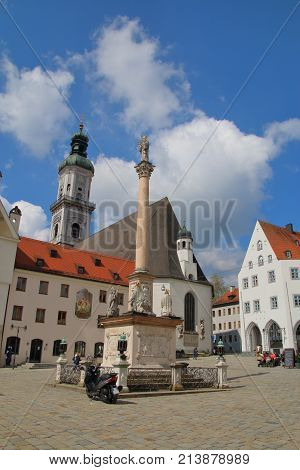 GERMANY-APRIL 19 2016: The central square of the old town of Freising in Bavaria. Modern transport on the ancient pavement. The connection between the past and the present.