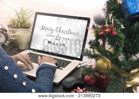 business woman hand typing computer keyboard on desk office concept office Christmas and happy new year.