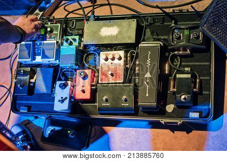 Case with amplifiers and sound modifiers for electric guitars before the concert