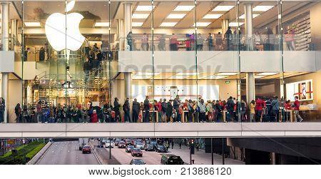 HONG KONG - DECEMBER,24,2013: People make shopping in Apple company megastore during Christmas holidays
