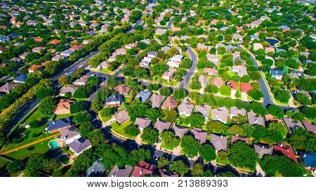 Springtime High Above The Never Ending Suburb. Aerial Drone View High Above Curved Modern Neighborho