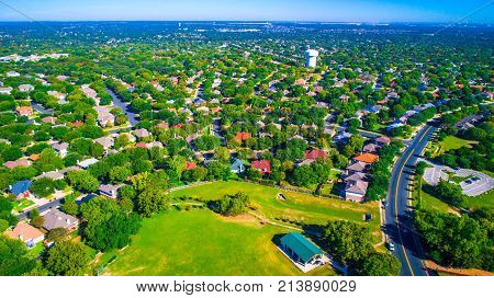 Aerial Drone View Vast Horizon Summer Time Green Suburb Above Public Park With Tall Green Trees In T