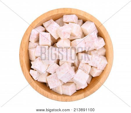 top view cube of taro root in wooden bowl isolated on white background