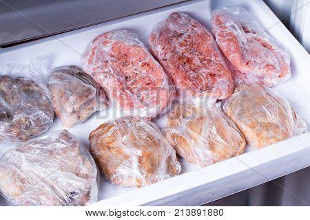 Frozen pork neck chops meat steakin the freezer
