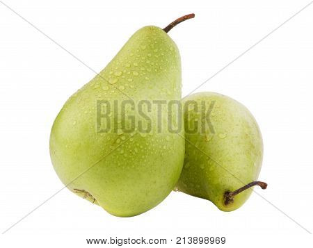 One pear rests on the other. Pears green in drops of water on a white isolated background