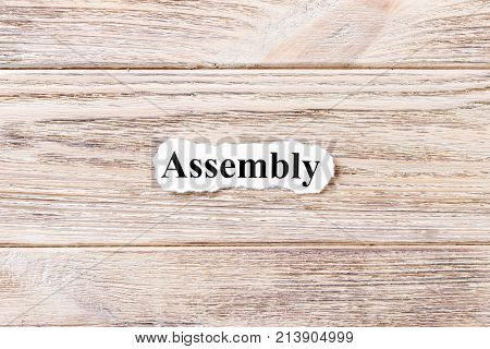 assembly of the word on paper. concept. Words of assembly on a wooden background.