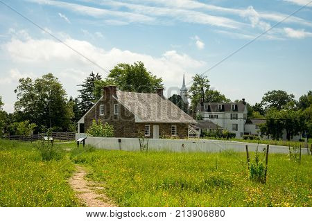 Historic Stone House And Small Town