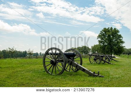 Row Of Cannon Artillery Pointing Over Landscape