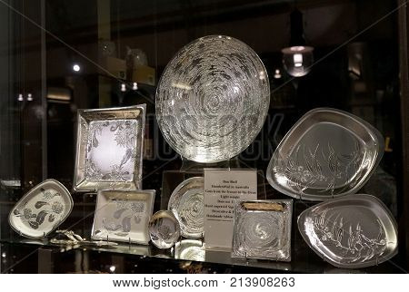 Sydney Australia - November 03 2017: A collection of exquisite alloy pieces with etchings of native Australian flora on window display - Don Sheil handmade tableware.