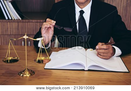 Judge gavel with Justice lawyers Businessman in suit or lawyer working on a documents. Legal law advice and justice concept.