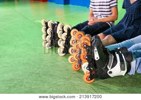 Group of teenagers wearing roller skates indoors, closeup
