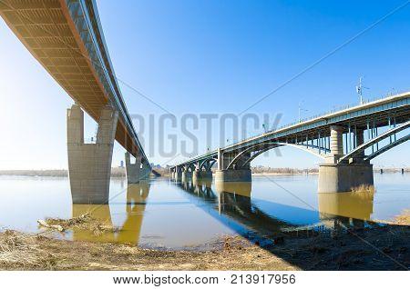 Two Bridges Across The River, One Metro Bridge Railway, And Automobile.