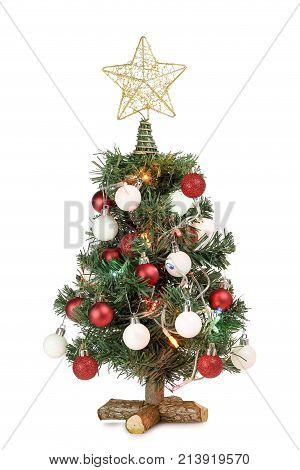 small christmas tree with ornaments and lights isolated on white