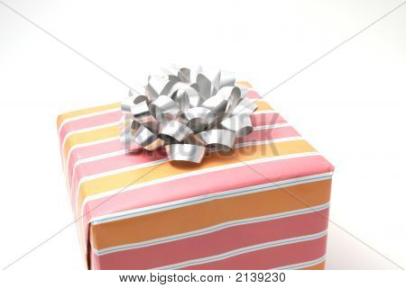 Box With Striped Paper And A Silver Bow