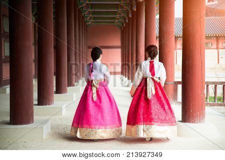 Asian Korean woman dressed Hanbok in traditional dress walking in Gyeongbokgung Palace in Seoul South Korea.