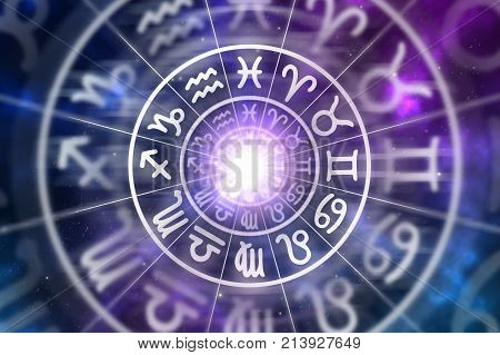 Astrological zodiac signs inside of horoscope circle on universe background - astrology and horoscopes concept poster