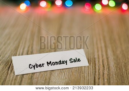 Sale Concept on wooden board and colored lights, selective focus, room for copy