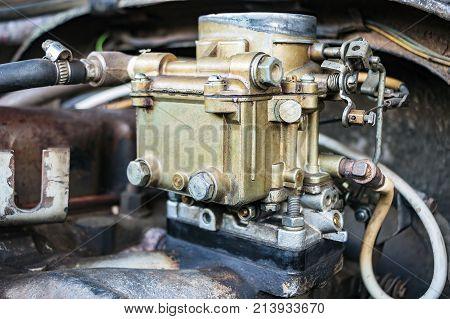 Old carburetor on an Vintage car engine