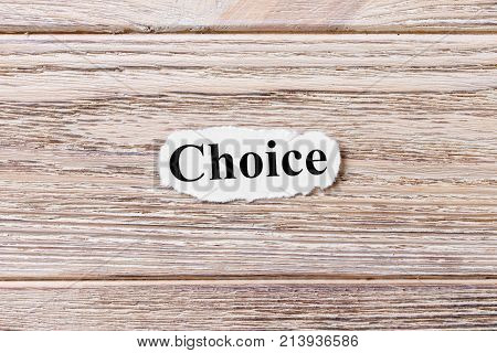 CHOICE of the word on paper. concept. Words of CHOICE on a wooden background.