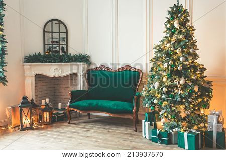 Christmas Living Room With A Fireplace, Sofa, Christmas Tree And Gifts. Beautiful New Year Decorated