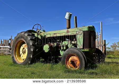 DOWNER, MINNESOTA, Oct 3, 2017:  The old John Deer R tractor is a product of John Deere Co, an American corporation that manufactures agricultural, construction, forestry machinery, diesel engines, and drivetrains