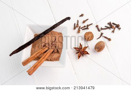 cinnamon, nutmeg and vanilla on a white background isolated