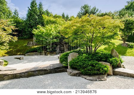 traditional japanese zen garden with trees in the background