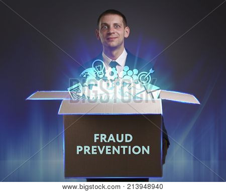 Business, Technology, Internet And Network Concept. Young Businessman Shows The Word: Fraud Preventi