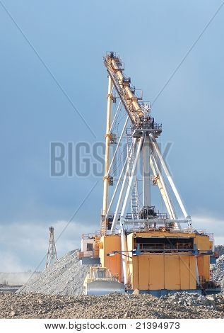 dragline and bulldozer in open cast mining quarry poster