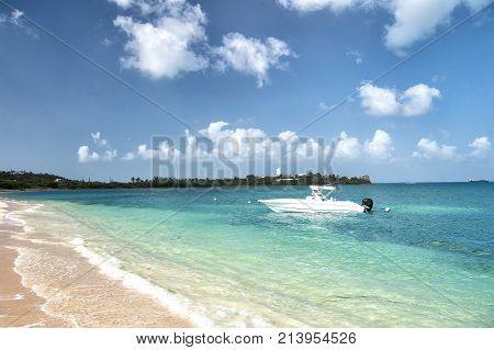 Boat or motorboat on sea or ocean water in Philipsburg St Maarten at tropical beach on sunny day on blue seascape. Summer vacation travelling wanderlust concept