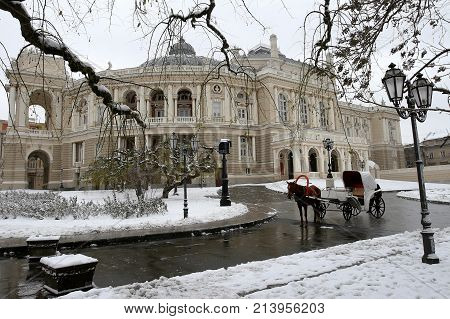 Carriage With Horse Near Odessa Opera House On Winter Day.