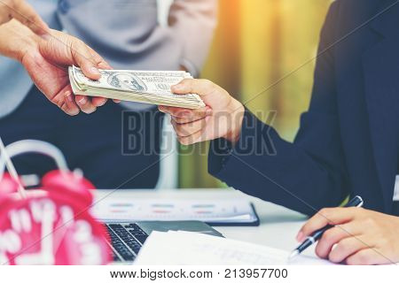 Business done deal concept : businesswoman handing money to contractor