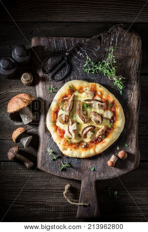 Hot And Fresh Rustic Pizza With Noble Mushrooms And Thyme
