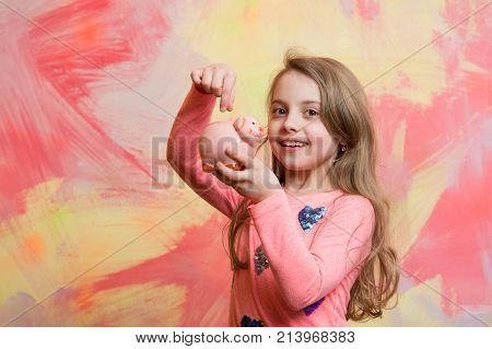 Girl Hold Moneybox Or Piggy Bank For Savings.