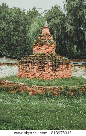 Chorten Made Of Red Colored Stones In A Garden In Bumthang, Bhutan