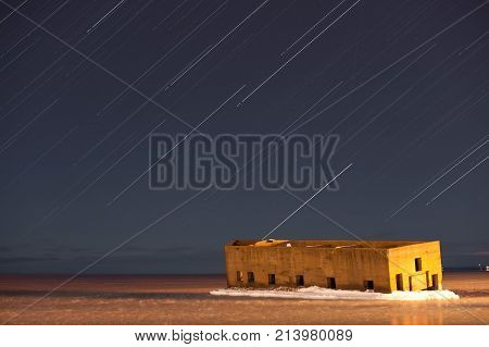 star trail over the icehouse of duluth, minnesota in winter