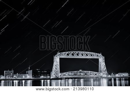 black and white star trail over the historic aerial lift bridge in duluth, minnesota